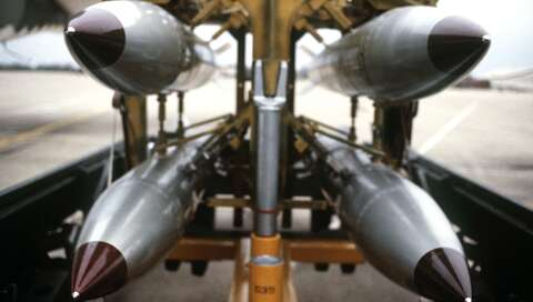 front view of four nuclear free-fall bombs on a bomb cart