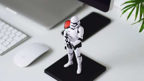 stormtrooper figure guarding computer and desk when we're away  | © Liam Tucker on Unsplash